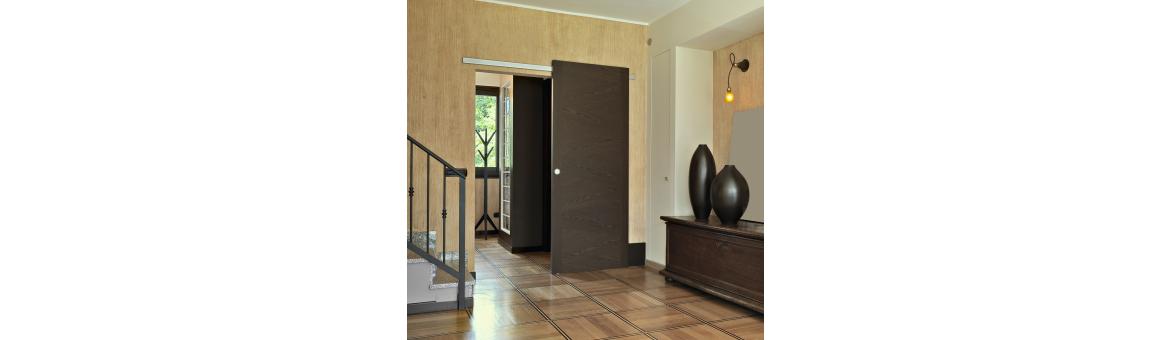 Kování na posuvné interiérové dveře